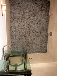 Custom guest bathroom in this Tempe rental home with luxurious river rock shower